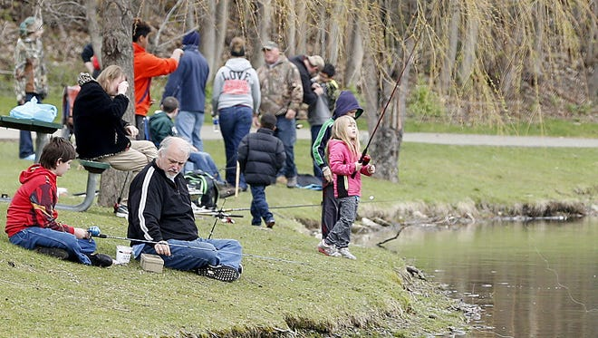 Children and families line Eldridge Lake for the 2016 Ed Pariso Kids Fishing Derby organized by the Catharine Creek chapter of Trout Unlimited.
