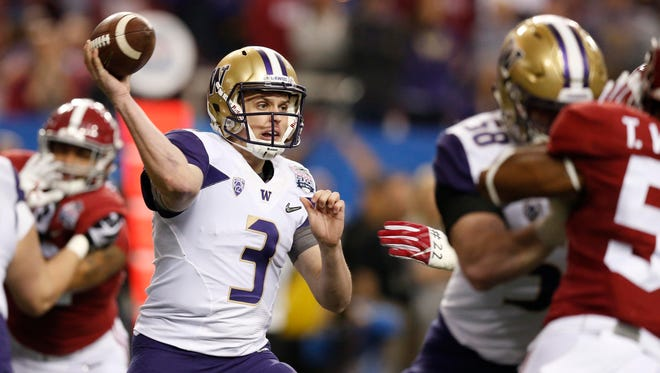 UW Jake Browning throws against Alabama during the CFP semifinal at the Georgia Dome.