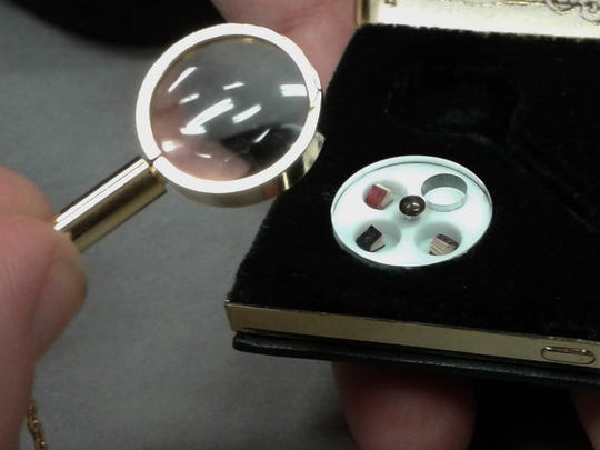 This set of extremely tiny books — measuring 2-by-2