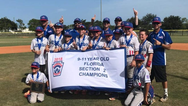 Players and coaches from the MCNLL 11U All Star team celebrate their win of the Section 2 Championship Tournament that took place in Delray Beach on July 7.