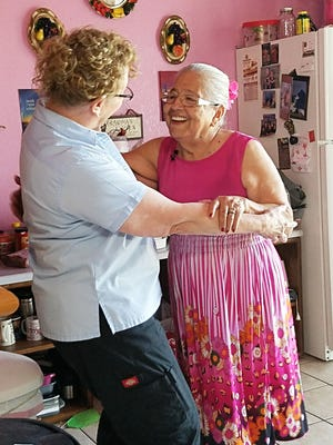 Dementia care educator Gail Higgenbotham found that music and dance help dementia patient Tomasa connect with those around her.