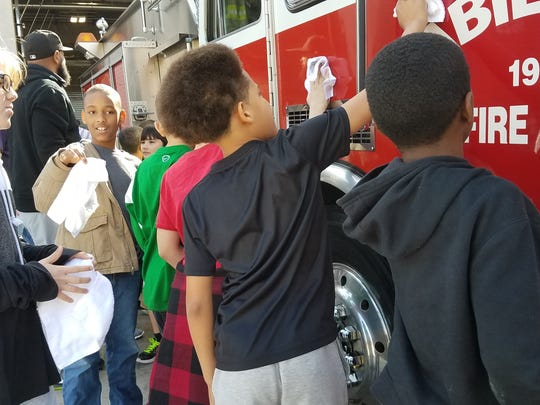 Children joined in to wash a fire truck at the dedication of Fire Station 3 Friday.