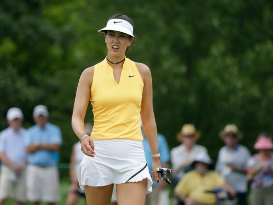 Michelle Wie reacts after a putt on the seventh green during the first round of the U.S. Women's Open Golf tournament Thursday, July 13, 2017, in Bedminster, N.J. (AP Photo/Seth Wenig)
