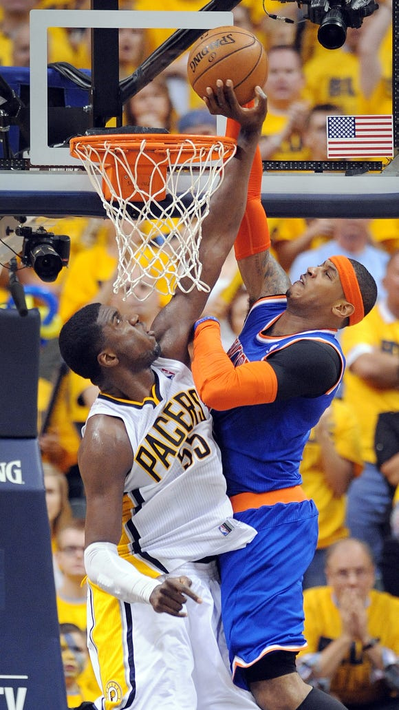 Pacers Roy Hibbert blocks the dunk attempt by the Knicks Carmelo Anthony. Pacers vs. Knicks in game 6 of the Eastern Conference semifinals Saturday, May 18, 2013, at Bankers Life Fieldhouse.  Matt Kryger / The Star
