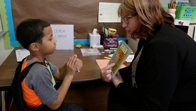 Amy Buelow, Instructional Support and Reading Recovery Teacher works with first grader Jaeden Solomon on his reading to get him up to speed with his peers.