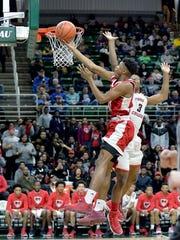 Flint Beecher freshman Earnest Sanders attempts a shot