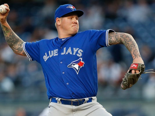 Toronto Blue Jays starting pitcher Mat Latos delivers during the first inning of a baseball game against the New York Yankees, in New York, Tuesday, May 2, 2017. (AP Photo/Kathy Willens)