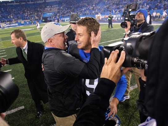 Austin MacGinnis with coach Mark Stoops.