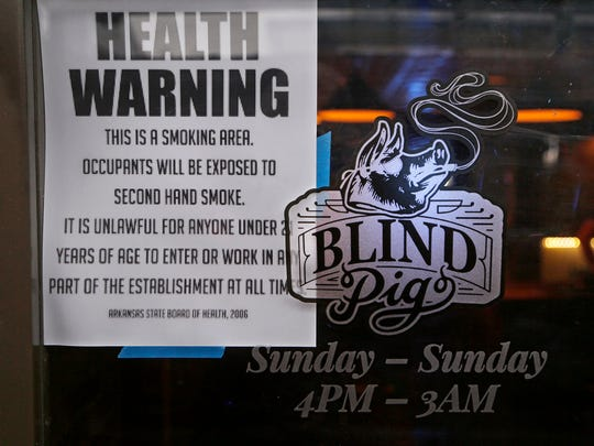 A note posted at both doors alerts potentional customers the Blind Pig is a smoking bar Friday, January 12, 2018, at the corner of Third and Ferry streets. All patrons and employees of the bar must be 21 years old or older.