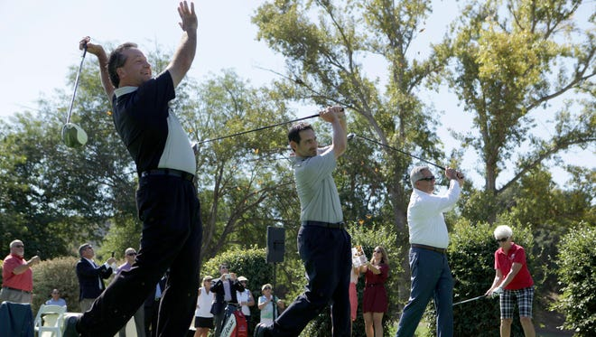 From left, Brian Reed, Jason Straka, Mayor Joel Price, and Karen Egizi are the first to tee off at the Los Robles Golf Course after a grand reopening ceremony held to honor the newly renovated golf course.
