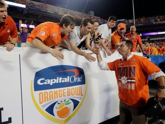 Clemson head coach Dabo Swinney greets fans after winning