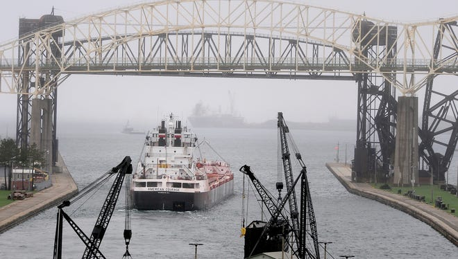 The 634-foot American Courage freighter heads towards Lake Superior through the Soo Locks on the locks system on the St. Marys River in Sault Ste. Marie May 12.  The U.S. locks are part of a 1.6 mile canal, the St. Marys Falls Canal, run by the U.S. Army Corps of Engineers.  The locks allow ships large and small to pass from the lower Great Lakes to Lake Superior and were built to avoid the rapids nearby.