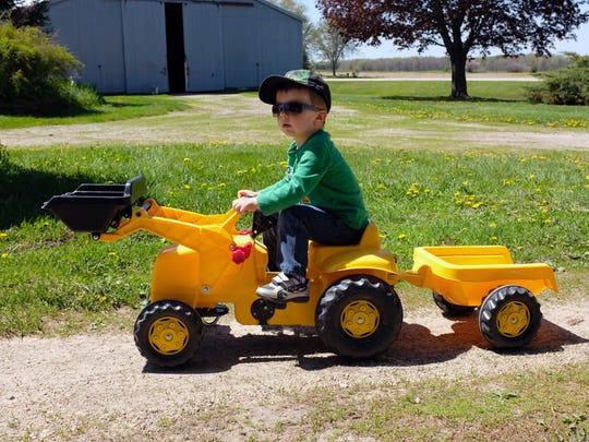 Wyatt rides his big machine. The grandchildren loved
