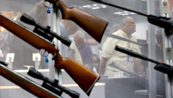 Guns are shown on display on April 25, 2014, at the NRA convention in Indianapolis. A bill in Indiana proposes a few changes to the state code that governs lawsuits against firearms manufacturers and sellers -- changes that the bill's chief proponent says targets a long-dormant lawsuit by the city of Gary.
