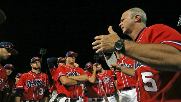 Mike Bianco talks to his team after a win against Mississippi State.