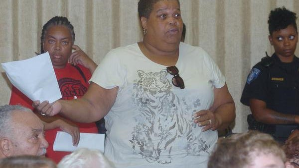 Concerned Grand Coteau residents speak up during an emergency meeting Friday to choose an interim mayor for the town.