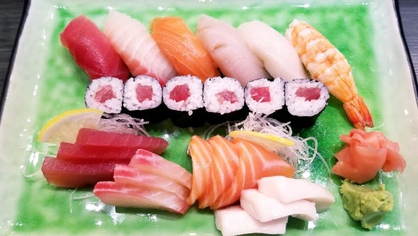 Kaishin's sushi combination is the chef's choice of five types of sushi, sashimi, a tuna roll and shrimp. It was garnished with ginger, wasabi, and decorative strands of radish. The fish he chose: salmon, escolar, Spanish mackerel, tuna and snapper.