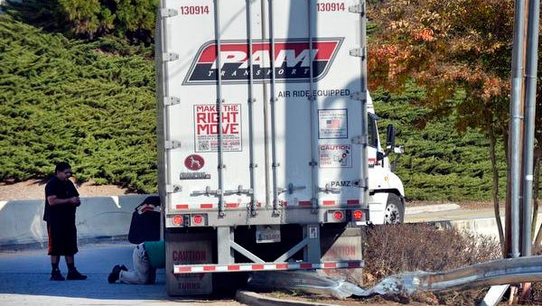 A tractor trailer ran up on a guard rail on the Interstate 385 on ramp at Laurens Road in Greenville on Wednesday, Nov. 12, 2014.