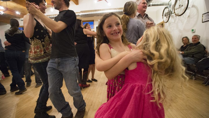 Emma Goodman, 7, spins her partner, Ruby Belcher, 5, during a barn dance at Wolverine Farm Letterpress and Publick House on Saturday, March 25, 2017. The Central Rockies Old-Time Music Association hosts a barn dance every month at locations around Fort Collins.