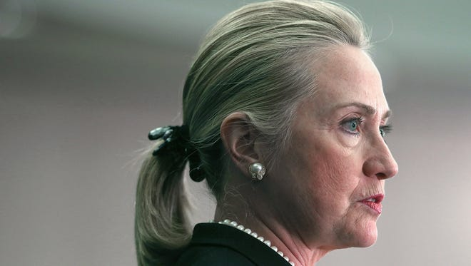 Presidential hopeful Hillary Clinton is picture in this 2012 file photo. In December 2012, she was treated for a blood clot between her brain and skull behind her right ear.