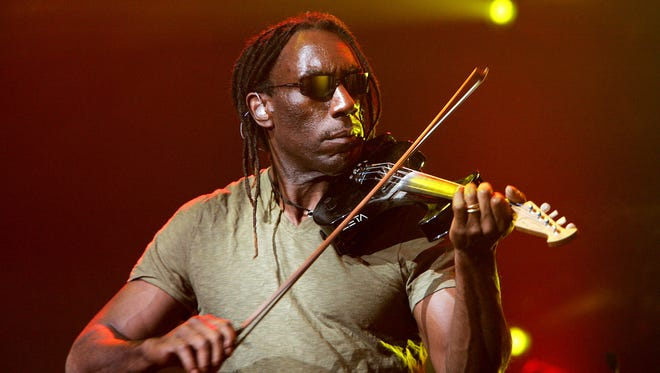 Boyd Tinsley of The Dave Matthews Band performs onstage during AOL Music LIVE! concert on May 9, 2005 in New York.