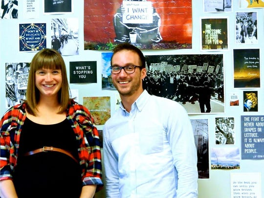 Urban Arts Coordinators, Emily Lang and Kristopher Rollins pose for a picture in their classroom at Central Campus.