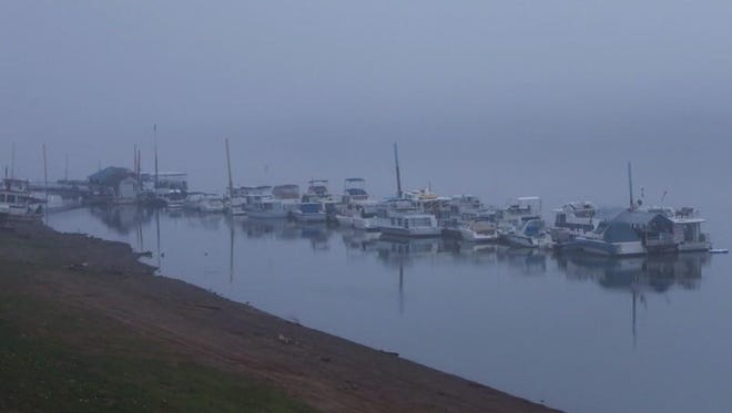 Dense fog shrouds the Ohio River in New Richmond on Tuesday morning.