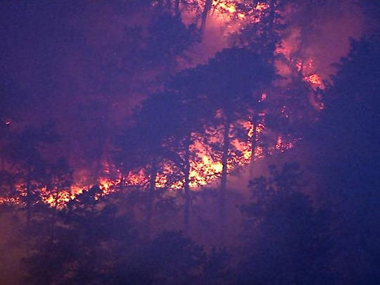 The fireline is shown Tuesday morning at a wildfire which broke out in the unincorporated Woodmansie section of Burlington County, near the Jackson border, burned nearly 1,000 acres of Pinelands before being contained overnight.
