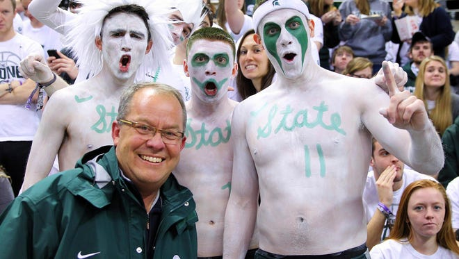 Michigan State Spartans athletic director Mark Hollis poses for a photo with members of the Izzone prior to a game at Jack Breslin Student Events Center in January 2014.