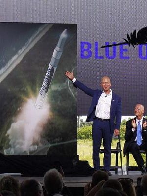 On Sept. 15, 2015, at Cape Canaveral Air Force Station's Launch Complex 36, Blue Origin founder Jeff Bezos unveiled plans to build and launch orbital rockets in Brevard County. Florida Gov. Rick Scott is seated at right.