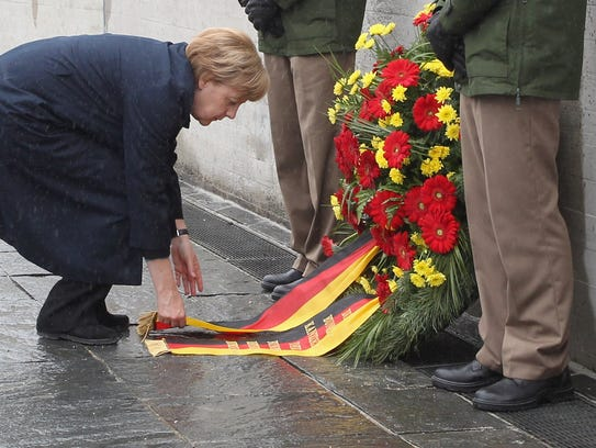 German Chancellor Angela Merkel lays down a wreath
