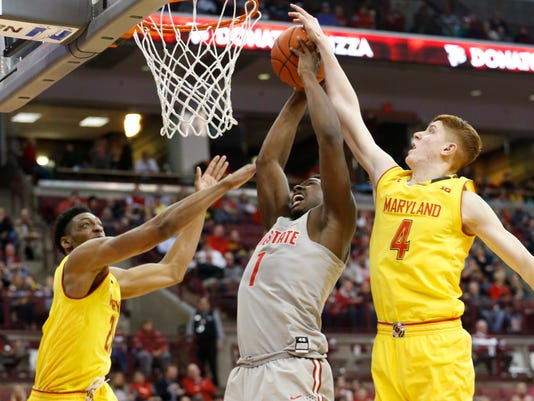 Ohio State's Jai'Sean Tate, center, tries to shoot the ball between Maryland's Justin Jackson, left, and Kevin Huerter during the second half of an NCAA college basketball game, Tuesday, Jan. 31, 2017, in Columbus, Ohio. Maryland defeated Ohio State 77-71. (AP Photo/Jay LaPrete)