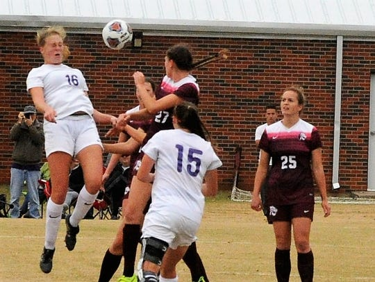 Hardin-Simmons senior defender Kirsten Parrish heads