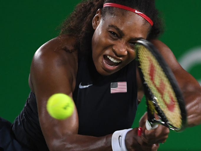 USA's Serena Williams returns the ball to France's