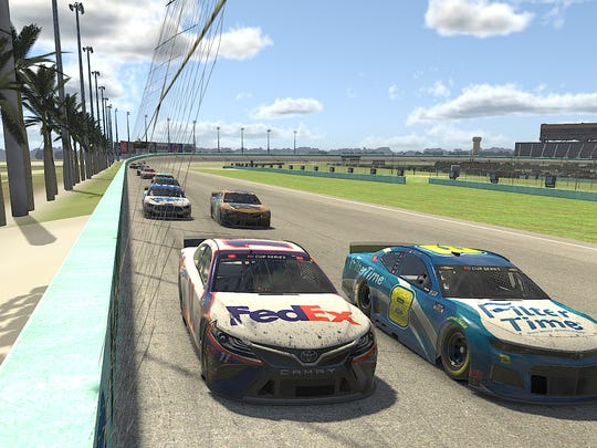In this computer-generated image, Denny Hamlin, in the No. 11 FedEx Toyota, races Dale Earnhardt Jr., in the No. 8 FilterTime Chevrolet, during the eNASCAR iRacing Pro Invitational Series Dixie Vodka 150 at virtual Homestead-Miami Speedway on March 22.