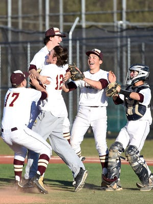 Arlington's pitcher, Mike Pascoe is hoisted up by teammate Connor Chiulli after pitching a no-hitter versus Mahopac on April 15, 2016.