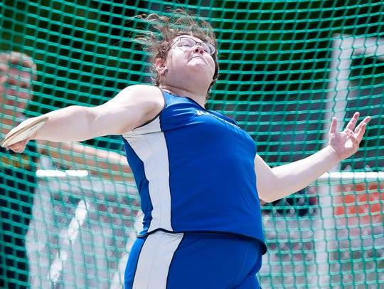 U-32's Molly McCreedy tosses the discus during the