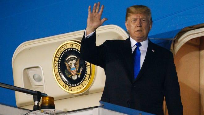 President Trump arrives at Paya Lebar Air Base for a summit with North Korean leader Kim Jong Un, Sunday, June 10, in Singapore.