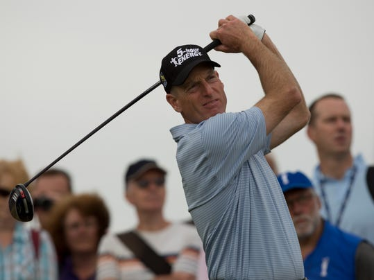 Jim Furyk of the US watches a shot off the seventh tee during a practice round at Royal Liverpool Golf Club prior to the start of the British Open Golf Championship, in Hoylake, England, Monday, July 14, 2014. The 2014 Open Championship starts on Thursday, July 17. (AP Photo/Jon Super)