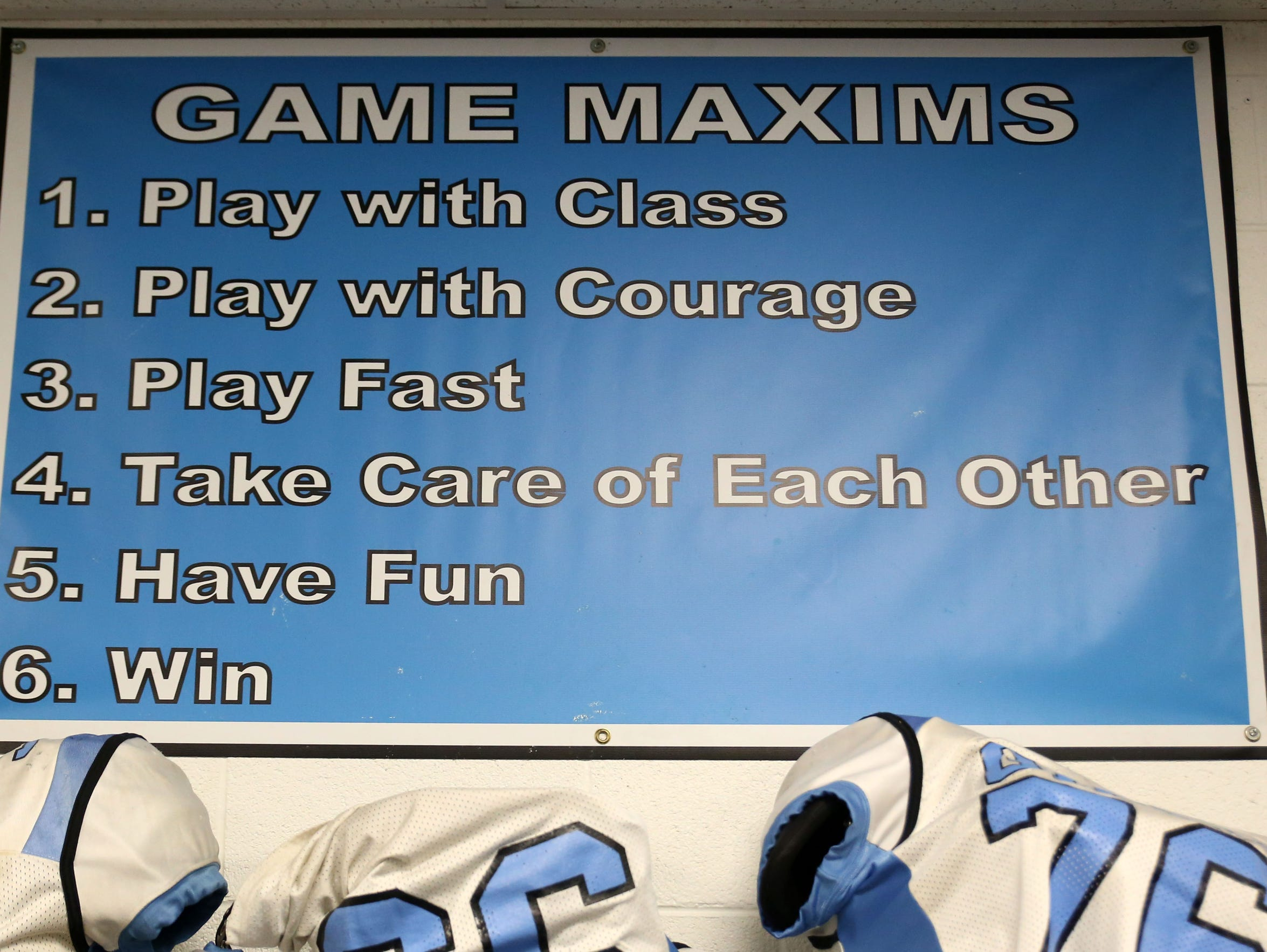 A list of maxims hangs in the locker room at Gibbs