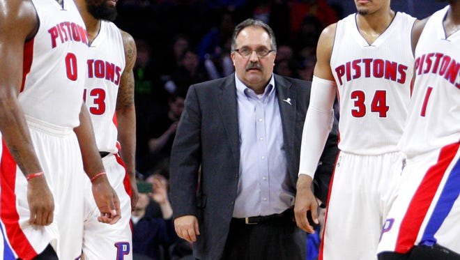 Mar 21, 2016; Auburn Hills, MI, USA; (Left to right) Detroit Pistons center Andre Drummond (0) forward Marcus Morris (13) head coach Stan Van Gundy forward Tobias Harris (34) and guard Reggie Jackson (1) stand during a timeout during the fourth quarter against the Milwaukee Bucks at The Palace of Auburn Hills.