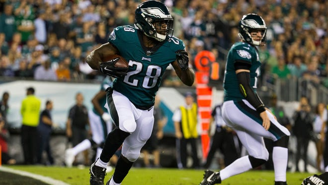 Eagles' running back Wendell Smallwood runs out of the end zone during a game against the Redskins last season at Lincoln Financial Field.