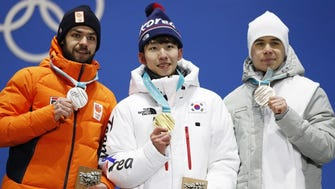 From left, silver medalist Sjinkie Knegt of the Netherlands, gold medalist Lim Hyo-jun of South Korea and bronze winner Semen Elistratov of the Olympic Athletes from Russia.