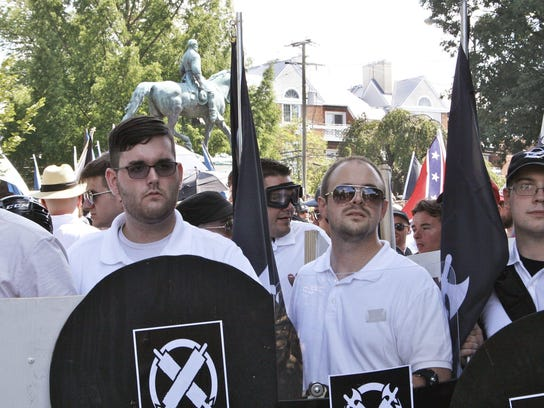 James Alex Fields Jr., second from left, is seen Aug. 12, 2017, in Charlottesville, Va., during a white supremacist rally. He later was charged with second-degree murder after authorities say he plowed a car into a crowd protesting the white nationalists.