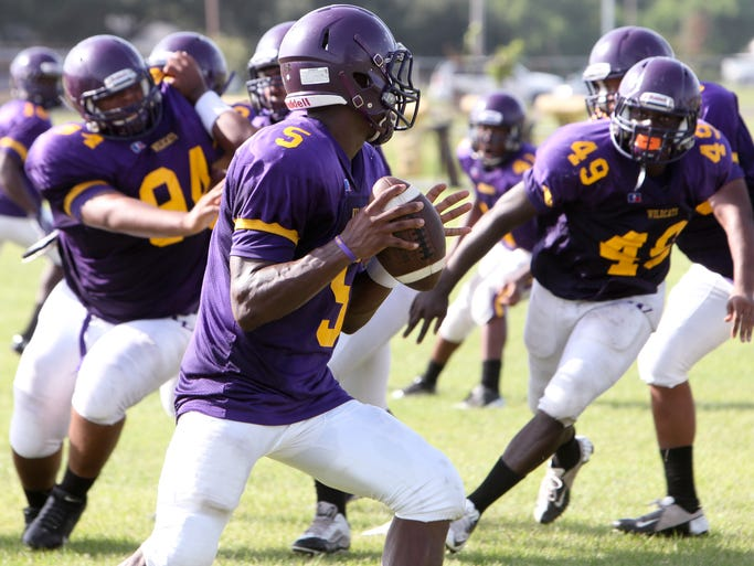 Wossman High School's football team practices Tuesday in preparation for the upcoming season.