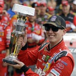 Kyle Busch celebrates after winning the NASCAR Brickyard 400 auto race at Indianapolis Motor Speedway in Indianapolis, Sunday.