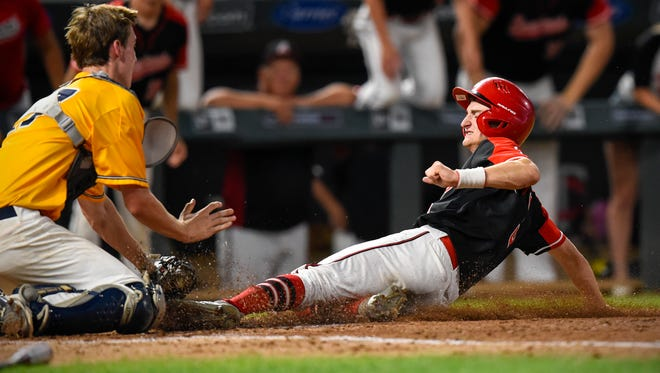 Rocori's Eli Emerson is tagged out by  Mahtomedi's catcher Charlie Bartholomew during the fifth inning Saturday, June 16, in the State Class 3A baseball championship at Target Field in Minneapolis.