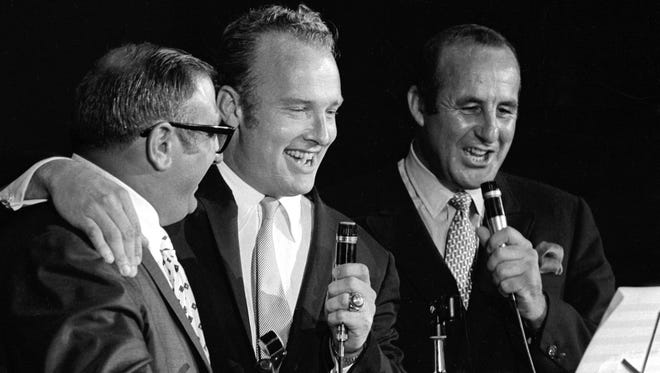 """Three former Packers players, Fuzzy Thurston, Paul Hournung and Max McGee sing a boisterous rendition of """"Run to Daylight"""" at Green Bay's Salute to Vince Lombardi held in early August 1968. Preceding the sold-out tribute to Lombardi at the Brown County Arena were many events honoring the former coach, including renaming the street in front of the Packers' stadium and offices to Lombardi Avenue."""