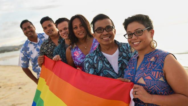 ISA Guam's founding members pose behind the LGBT pride flag at Alupang Beach in Tamuning on June 22. From right: Monaeka Flores, Alan Torrado, Lasia Casil, James Servino, Raymond Anderson and Jason Padua.
