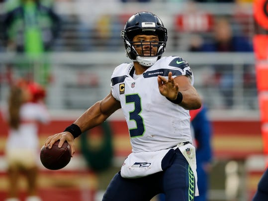 FILE - In this Nov. 26, 2017, file photo, Seattle Seahawks quarterback Russell Wilson (3) throws against the San Francisco 49ers during the first half of an NFL football game in Santa Clara, Calif. Wilson is the primary offensive reason why Seattle has playoff hopes going into the regular season finale against the Arizona Cardinals. (AP Photo/John Hefti, File)